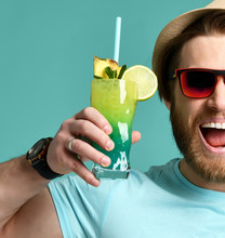 Young Man In Hat And Red Sunglasses Hold Cocktail Drink Juice Happy Screaming