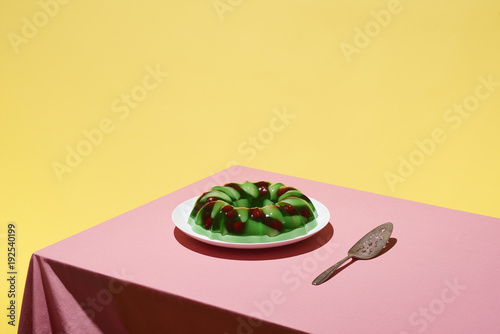 Aluminium Prints Food Jello fruit salad served on a plate on a pink tabletop