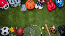 Various Sport Equipments On Gr...