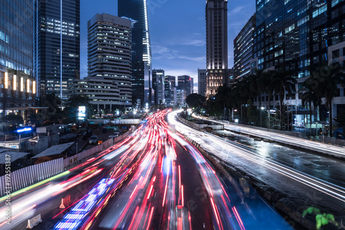 Poster Asian Famous Place Traffic rushing in Jakarta business district at night in Indonesia capital city
