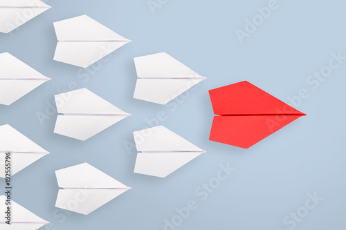 Leadership concept with red paper ship leading among white Wallpaper Mural