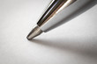 The tip of the ballpoint pen is close-up.