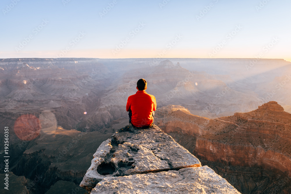 young boy at the edge of the cliff in colorado grand canyon, Usa