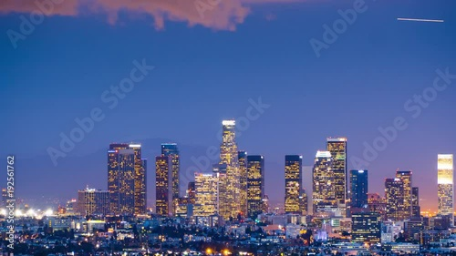 Sticker - Zoom out from downtown Los Angeles skyline twilight night city. 4K UHD Timelapse