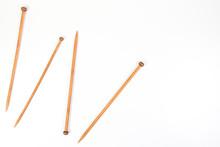 Wooden Knitting Needles On Whi...