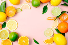 Citrus Fruits Frame On Pink Background