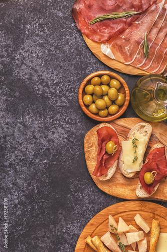 Italian food  background with ham, cheese, olives. © tbralnina