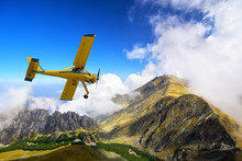 Old And Vintage Cessna Plane Flying Above Carpathian Mountain Peaks In Romania