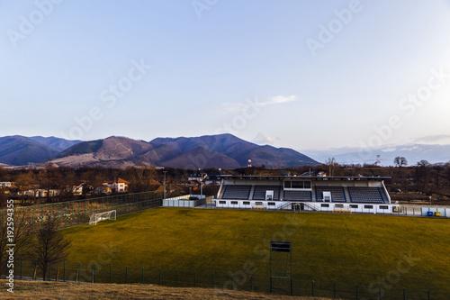 Fotografie, Obraz  a football field in a mountain village