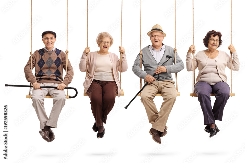 Fototapety, obrazy: Cheerful seniors sitting on wooden swings and looking at the camera