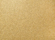 Glitter grain of gold on rough golden plate, closeup photo on rough golden plate surface show a detail of gold glister texture on gold plate, golden background, texture background, abstract background