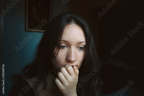 Fotografie, Tablou thoughtful girl with her hand on her lips