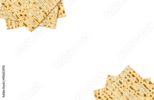 Matzo on white background with space for text. Top view, flat lay.