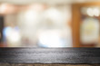 Wooden table with blur background of coffee cafe.
