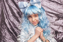 A Cute Young Girl Dressed In A Blue Carnival Costume Of Malvina