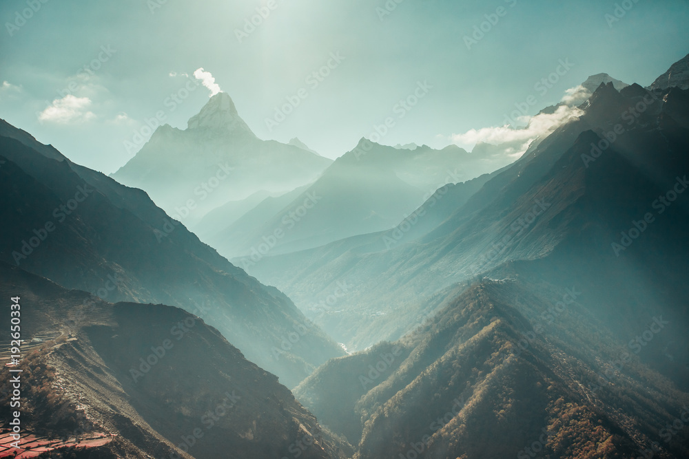 Fototapety, obrazy: The breathtaking panoramic view the mighty misty snow-capped Himalayas and the canyons with the coniferous forests. Nepal. Ideal background for the various kinds of collages and illustrations.
