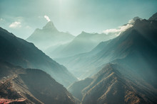 The Breathtaking Panoramic View The Mighty Misty Snow-capped Himalayas And The Canyons With The Coniferous Forests. Nepal. Ideal Background For The Various Kinds Of Collages And Illustrations.