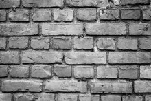 Old Deteriorated Brick Wall Texture Background In Black And White With Vignetting.
