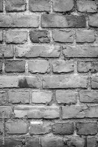 Fotografia, Obraz  Old deteriorated brick wall texture background in black and white with vignetting