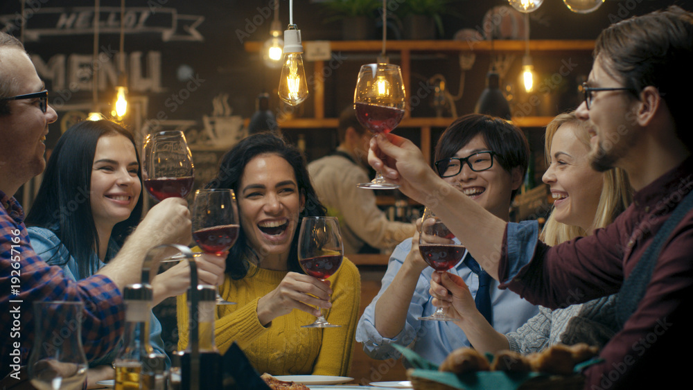 Fototapety, obrazy: Diverse Group of Friends Celebrate with a Toast and Clink Raised Wine Glasses in Celebration. Beautiful Young People Have Fun in the Stylish Bar/ Restaurant.
