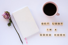 Book, Cup Of Coffee, Dried Flower, Tile Letter Quote On White Desk