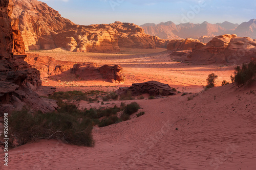 Foto op Plexiglas Bruin Red mountains of the canyon of Wadi Rum desert in Jordan. Wadi Rum also known as The Valley of the Moon is a valley cut into the sandstone and granite rock in southern Jordan to the east of Aqaba.