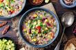 Vegetable quinoa soup with avocado, corn, beans.