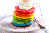 Fototapeta Tęcza - Rainbow pancakes, served in pile