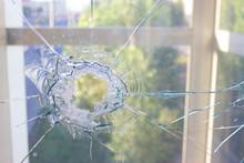 Broken Glass Window Reflecting...