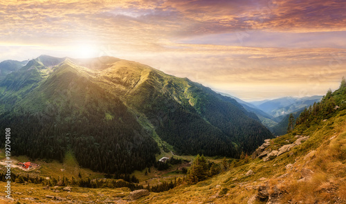 Fotobehang Landschap Majestic mountain landscape. colorful clouds in the sunset sky. over the mountains hills, gloving in sunlight . wonderful nature scenery. artistic creative image.. Transfagarasan road