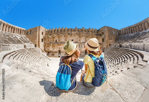 Photo Stands Athens Two young girls student traveler taking selfie the ancient Greek amphitheater