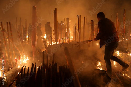 People burn incense sticks and pray for good fortune at