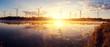 Leinwandbild Motiv Windmills for electric power production on the field. wonderful sunny sunrise on lake.