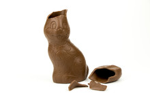 Chocolate Easter Bunny With Broken Ears Isolated On White