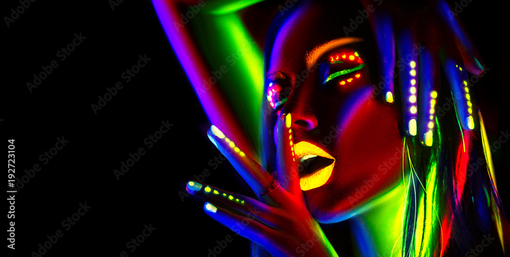 Fototapeta Fashion model woman in neon light. Portrait of beautiful model girl with colorful fluorescent makeup