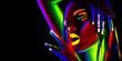 Leinwandbild Motiv Fashion model woman in neon light. Portrait of beautiful model girl with colorful fluorescent makeup