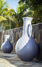 Large Decorative Amphorae Standing On A Terrace While Sunset On Mauritius Island