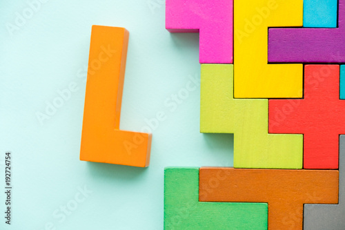 Business creative solution concept - jigsaw. Colored wooden plates panel Background Texture