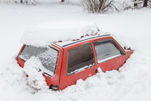 Red Car Under Snow In Snowbank...