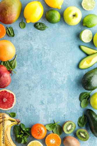Poster Vruchten top view of different selected juicy organic tropical fruits, superfood, healthy eating concept, frame with blank space for a text