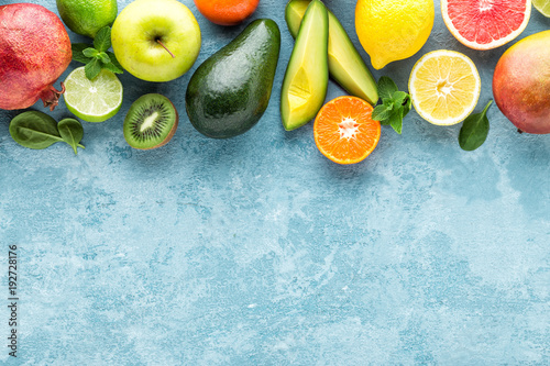 Foto op Aluminium Vruchten top view of different selected juicy organic tropical fruits, superfood, healthy meal concept, healthy food background