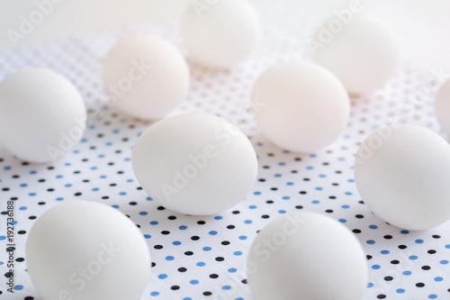 Fototapety, obrazy: White eggs on polka dot fabric