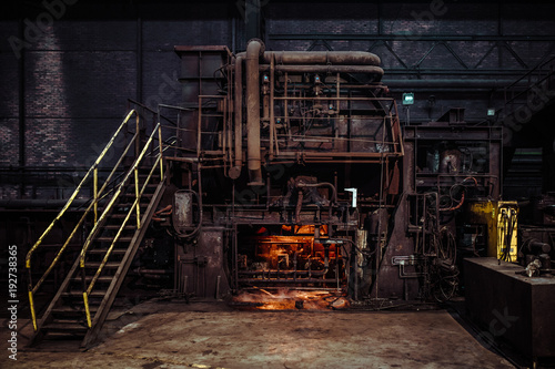 Photo Stands Old abandoned buildings interior of an old abandoned steel factory in western Europe