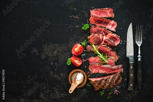 Sliced medium rare grilled beef ribeye steak Wallpaper Mural