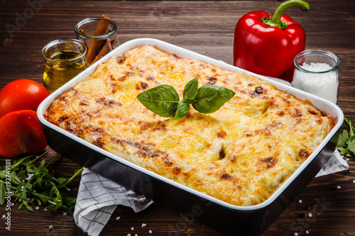 Lasagna on wooden table