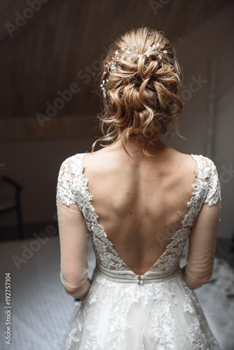 Fotografija Elegant bridal hairstyle with a hairpin and curls