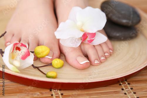 Foto op Plexiglas Care for beautiful woman legs with flower . Beautiful woman legs