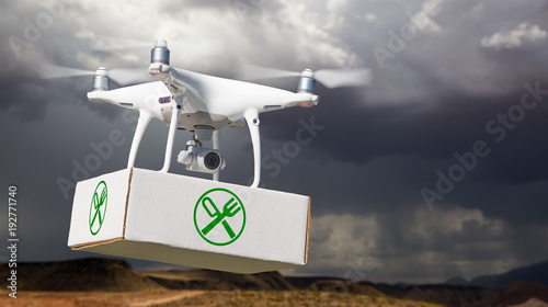 Unmanned Aircraft System (UAV) Quadcopter Drone Carrying Package With Food Symbol Label Near Stormy Skies.