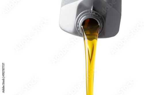 pouring motor oil from silver plastic canister isolate on white background