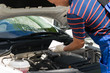 Checking the oil in the car's auto engine, for topping up